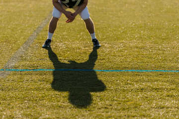 Shadow of a football player