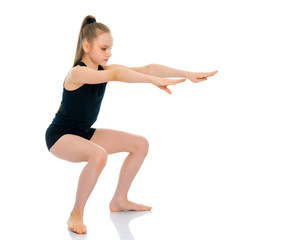 The gymnast perform an acrobatic element.