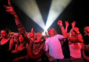 Revellers enjoy the performance of Depeche Mode at the Paleo Festival in Nyon