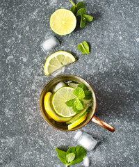 Copper mug of lemonade with mint, top view