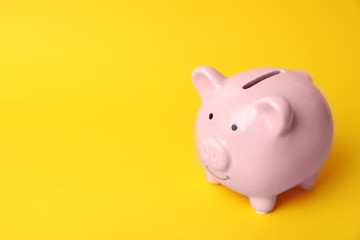 Pink piggy bank on color background. Money saving