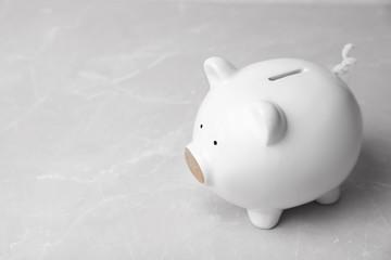 White piggy bank on table. Money saving