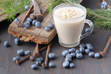 Healthy breakfast: overnight oats with fresh blueberries in a glass jar