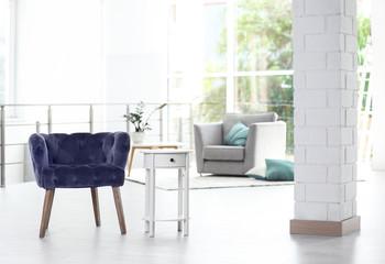 Elegant room interior with stylish comfortable armchairs