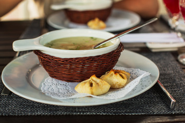 Delicious Chicken  Soup in a Beautiful White Bowl, Decorated Basket With Tasty Bun