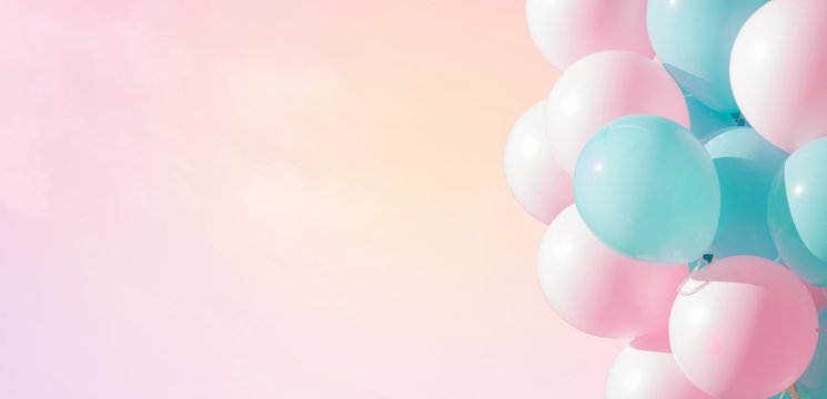 Beautiful panoramic background with pink and blue balloons