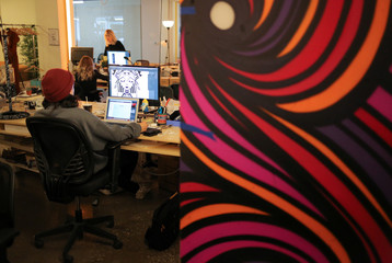Staff at Inkbox, a temporary tattoo start-up, work on designs at their offices in Toronto