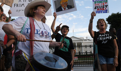 Protesters rally outside the White House in Washington