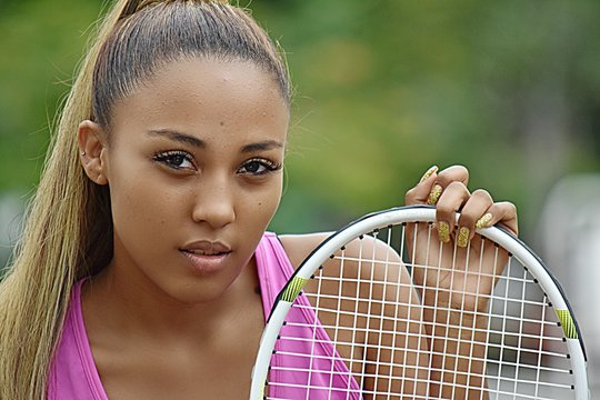 Unemotional Latina Girl Tennis Player Youth