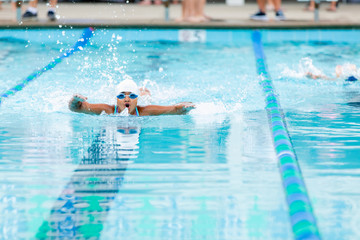 Little Girl Swimming Fast at a Swim Meet Competition