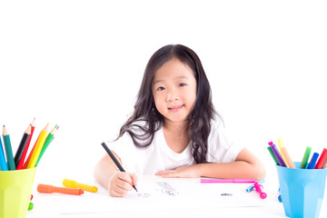 Young asian girl drawing picture over white background