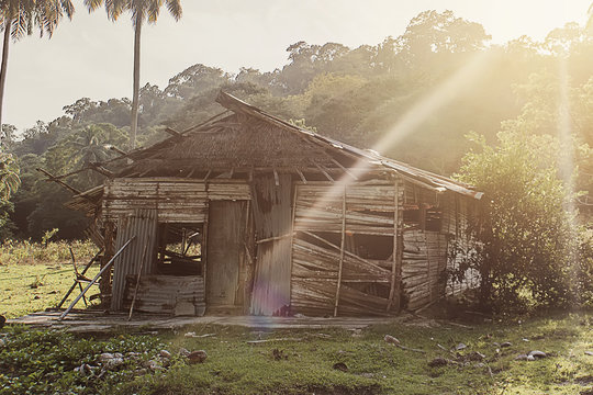 Rustic old shack in the jungle rainforest in South East Asia