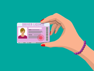 Car driver woman license in hand