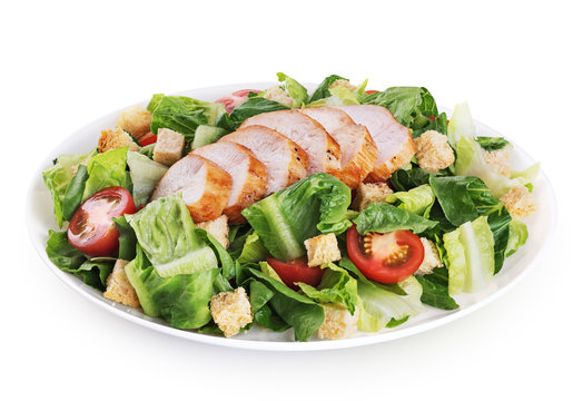 Caesar salad with chicken fillet  isolated on white background.