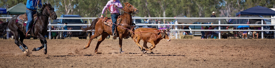 Team Calf Roping At A Country Rodeo