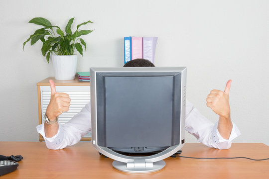 businessman hiding behind his computer screen empty with thumbs up