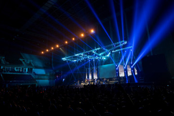 music brand showing on stage or Concert Live and Defocused entertainment concert lighting on stage with Laser rays beams, party concept