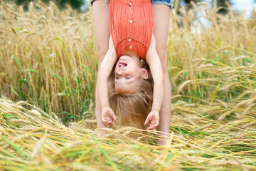 lovely blonde eating bread in a wheat field
