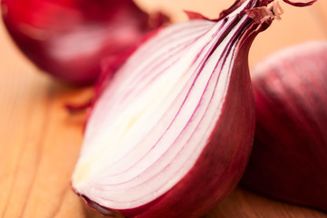 Close-up of red onion on wooden background selective focus