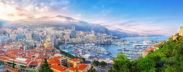 Principality of Monaco. Beautiful panoramic view on Monaco, golden hour scenery. View on apartment building, casino, great port with luxury yachts. Monaco is popular travel destination, wealth symbol. Fototapete