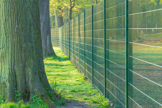 Metal fence in urban Park