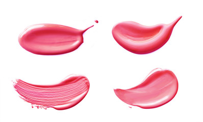 Nail polish cosmetic smear cream isolated on white background. Pink liquid sample smear of lipstick