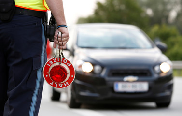 Bavarian Police Officer controls cars at a temporarily checkpoint on the motorway between the Austrian and German border in Kirchdorf