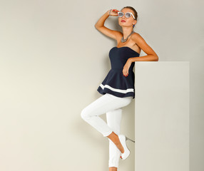 Slim young woman in studio and fashion photo .