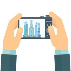 Photographer with a camera in his hands. Snapshot of cityscape. Flat cartoon illustration. Objects isolated on white background.