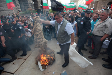 Protester burns wool during a rally in Sofia