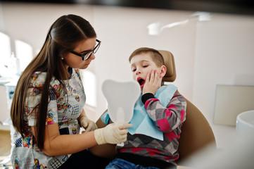 Little boy at dentist chair. Children dental.