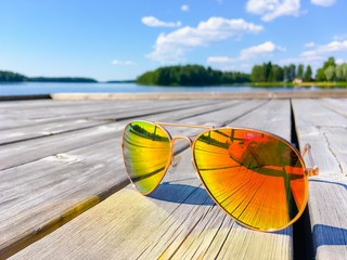 Finnish summer landscape and sunglasses. Photo from Sotkamo, Finland.