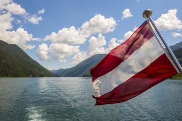 Austria, Carinthia, Austrian flag on boat on Lake Weissensee