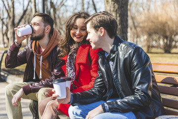 Russia, Moscow, group of friends at park having fun together, drinking coffee