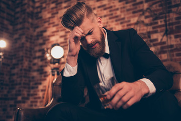 Single bachelor freelancer entrepreneur misfortune mood people concept. Sad upset unhappy virile poor disappointed guy with modern hairdo drinking rum because lost all his money when gambling