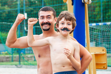 Father and son on the playground are having fun together. Promotion of healthy lifestyles