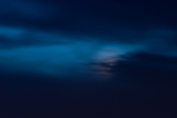 Moon hidden behind cloud
