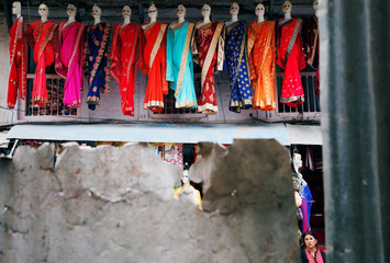 Mannequins are displayed outside a clothing shop in Kathmandu