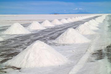 Piles of the drying salt on the Uyuni salt flats or Salar de Uyuni, Potosi, Bolivia, South America