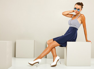 slim young woman in studio and free space for your decoration.