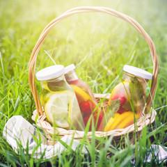 Autocollant pour porte Pique-nique Selection of summer lemonades. Basket on the meadow with refresh