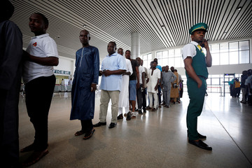 Passengers queue at the ticket checking point of the newly commissioned Abuja light rail train in Abuja