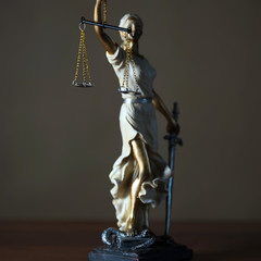 Themis with scales in lawyers office.  Statue of blind goddess