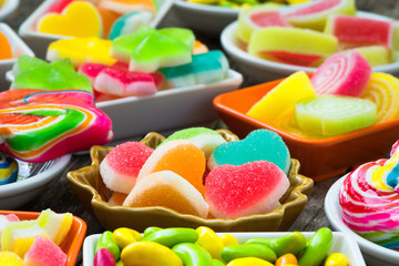 Various colorful sugary candy in container