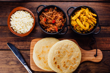 Arepas and its ingredients seen from above
