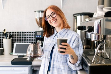 Girl waitress serves a Cup of coffee