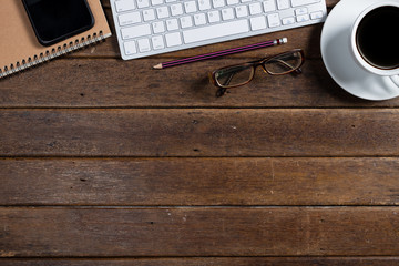 Modern dark wooden office desk table with computer and smartphone cup of coffee. Hero Header Concept with Copy space.