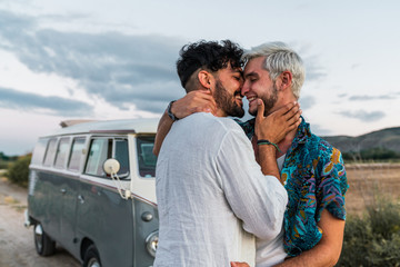 Gay couple kissing in nature