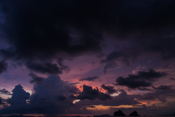 Twilight sky with colorful and cloudy from strom coming over the beach