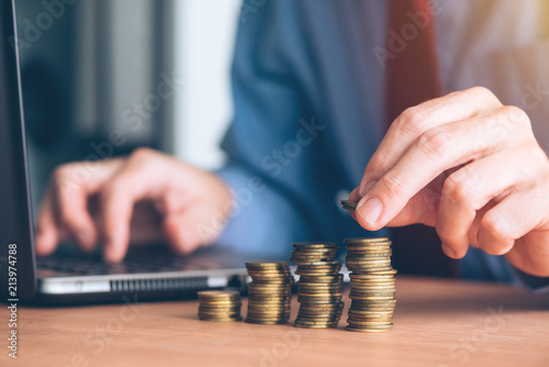 finances and budgeting businessman stacking coins stock photo and